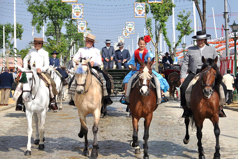 SEVILLE, SPAIN, riders mounted on horses by the fa