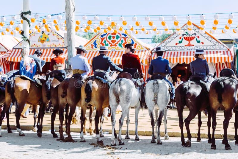 Group of riders on horseback at the April Fair, Seville Fair Feria de Sevilla. Seville, Spain - April 18, 2018: Group of riders on horseback at the April Fair stock images