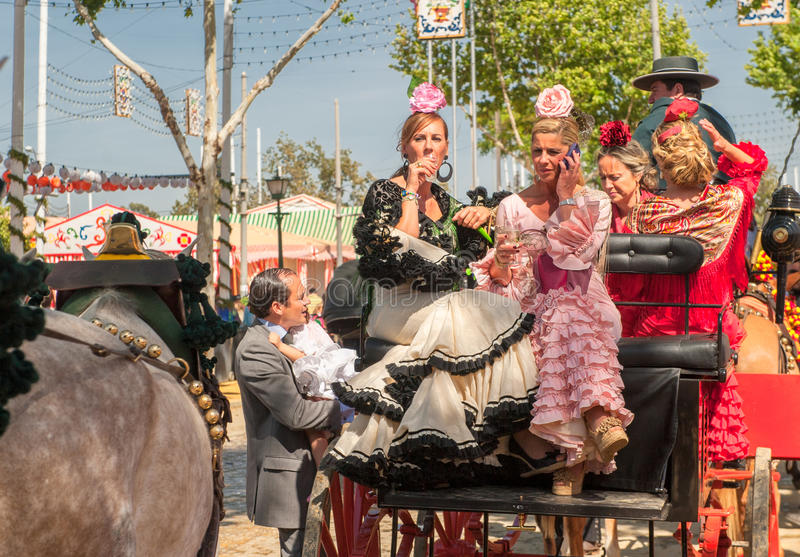 SEVILLE, SPAIN - April, 25: Parade of carriages at the Seville's. April Fair on April, 25, 2012 in Seville, Spain stock photography