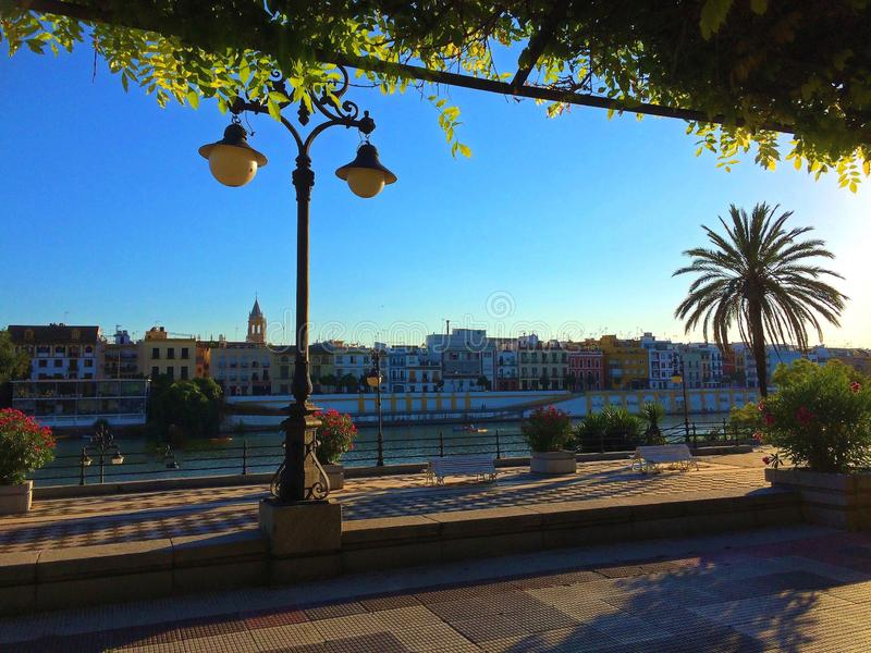 Seville, Spain - Guadalquivir River and Triana Neighbourhood. Seville, Spain, Waterfront view to the historic architecture of the Triana stock photography