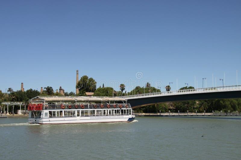 River pleasure boat on the Guadalquivir River in Seville stock photos