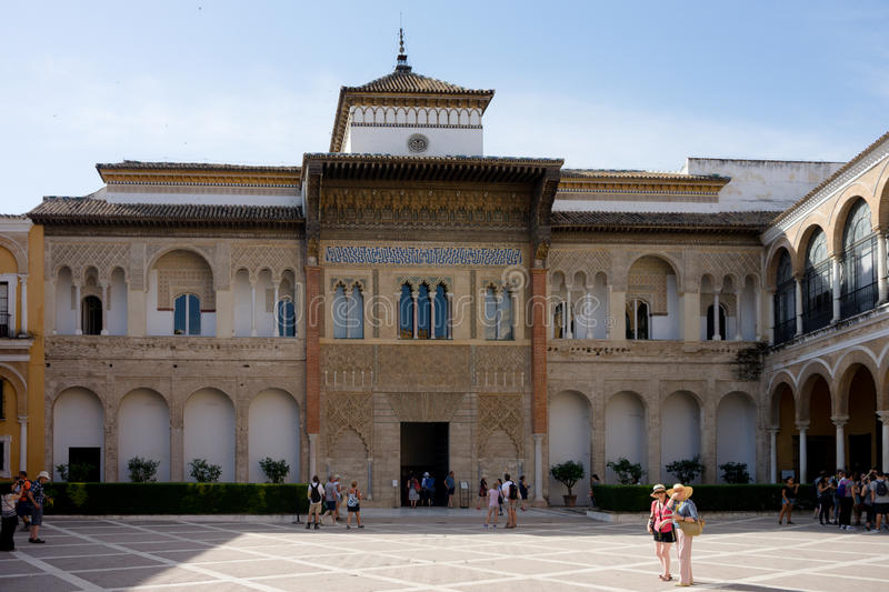 Seville, Spain - June 19: The real Alcazar, Seville, Spain on June 19, 2017. Tourists walking in the courtyard on a warm summer d royalty free stock photos