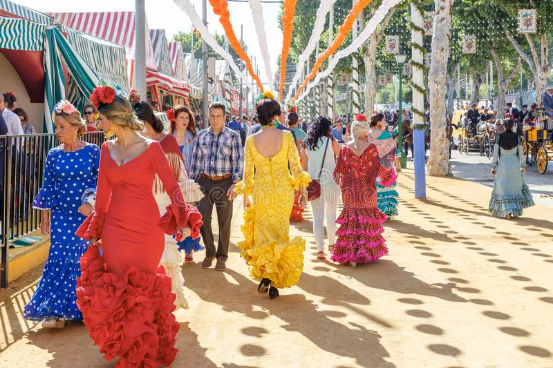 Seville, Spain - May 03, 2017: People taking a walk and dressed. In traditional costumes at the Seville`s April Fair stock photography