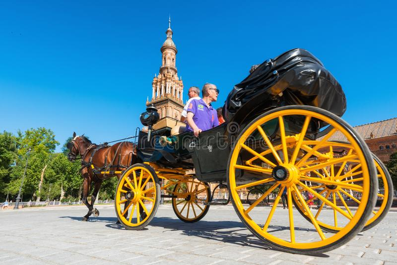 Seville, Spain - May 21, 2019: - Tourists taking a ride in a horse drawn carriage in the Plaza de Espana, Seville stock photo