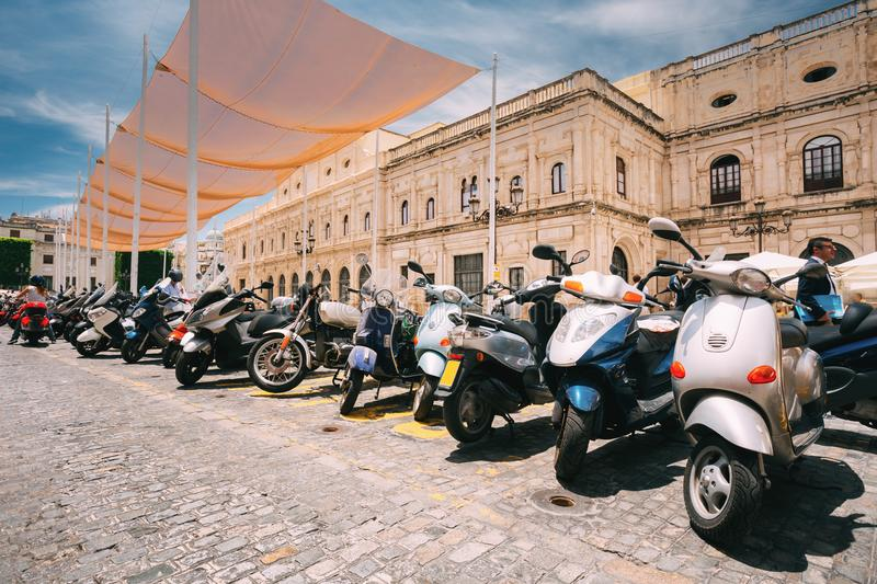 Seville, Spain. Motorbikes, Motorcycles, Scooters Parked In City royalty free stock images