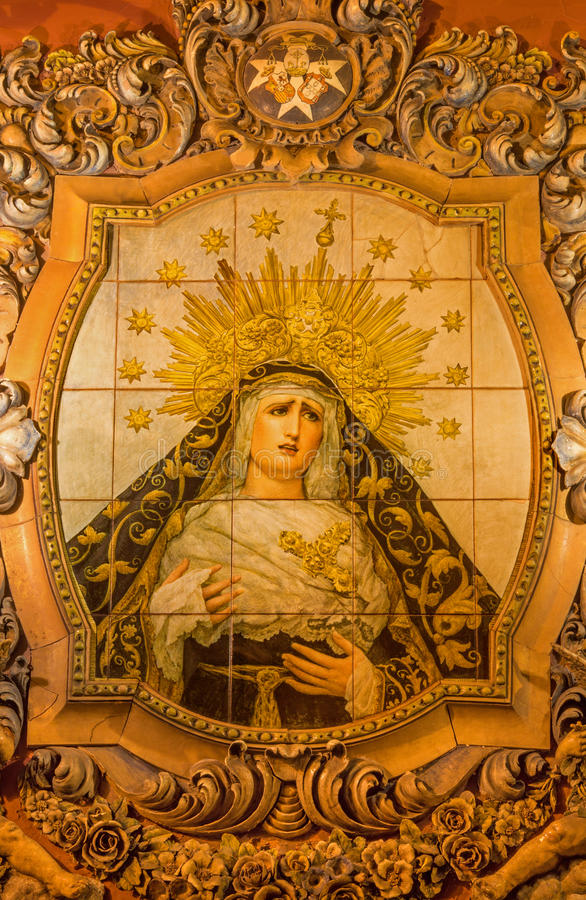 SEVILLE, SPAIN - OCTOBER 29, 2014: The ceramic tiled, cried Madonna on the facade of church Iglesia San Bonaventura. By Enrique Orce Marmol 1951 stock image