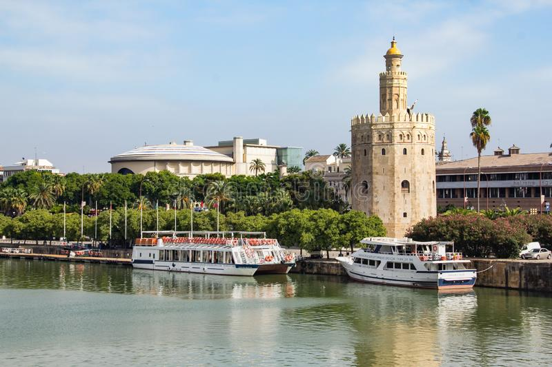 Seville, Spain - Sept. 23, 2013: Torre del Oro on the Guadalquivir river. Tower of Gold with Tour boats along the Guadalquivir river stock photo