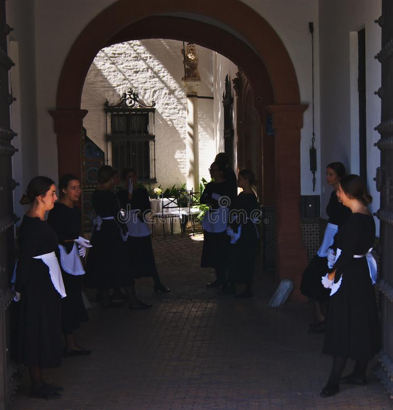 Seville, Spain - 28 september 2019: A group of young servants ready to welcome their hosts. Seville, Spain - 28 september 2019: A group of young servants royalty free stock image