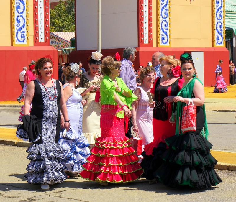 Seville Spain/1Seville Spain/16th April 2013/ Tourist and locals. Seville Spain/16th April 2013/ Tourist and locals in bright traditional dress dance at the royalty free stock photo
