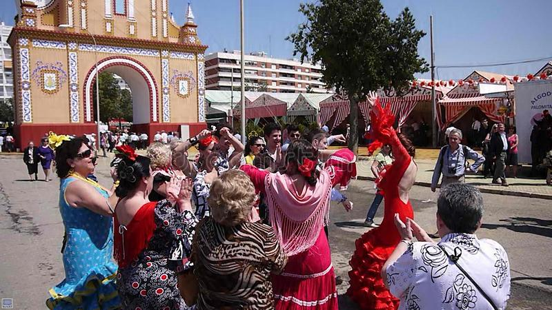 Seville Spain/1Seville Spain/16th April 2013/ Tourist and locals. Seville Spain/16th April 2013/ Tourist and locals in bright traditional dress dance at the royalty free stock image