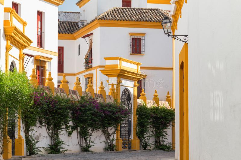 Seville, Spain - Traditional yellow and white Architecture barrio Santa Cruz district. Seville, Spain - Architecture barrio Santa Cruz district royalty free stock images