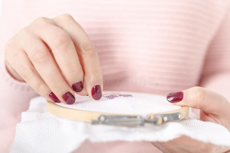 Sew or embroider using cross-stitche royalty free stock photo