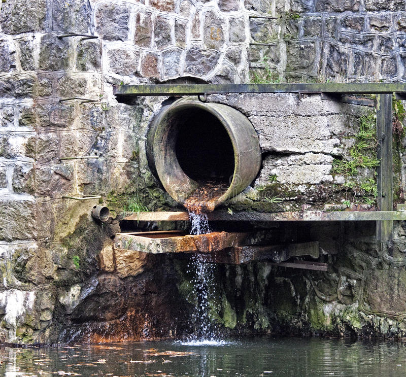 Sewage pipe. On a dam royalty free stock image