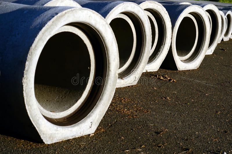 Sewage pipes. Construction of a sewer, with concrete pipes stock image