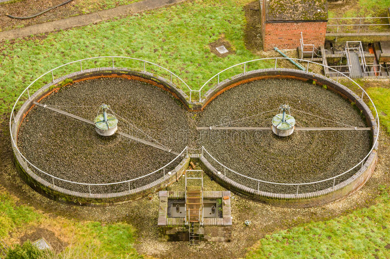 Sewage Treatment Filter Beds. Sewage treatment trickling filter beds or a biological filter using a bed of stones or gravel waste water is irrigated through the stock image