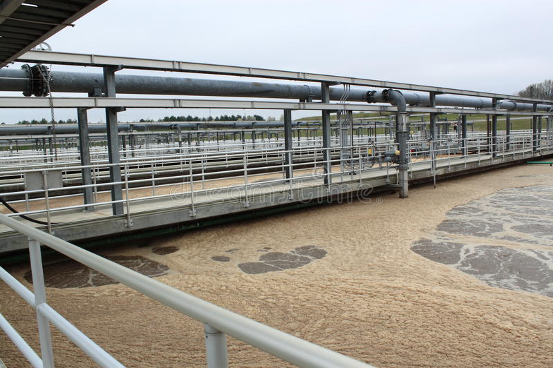Sewage treatment plant. Aerated sludge tank at a waste-water treatment plant stock photography