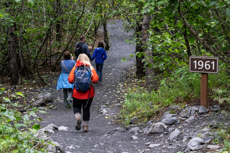 SEWARD, ALASKA - AUGUST 6, 2018: Hikers set out on the Harding Ice Field Trail. In Kenai Fjords National Park. This trail also includes the Exit Glacier royalty free stock images