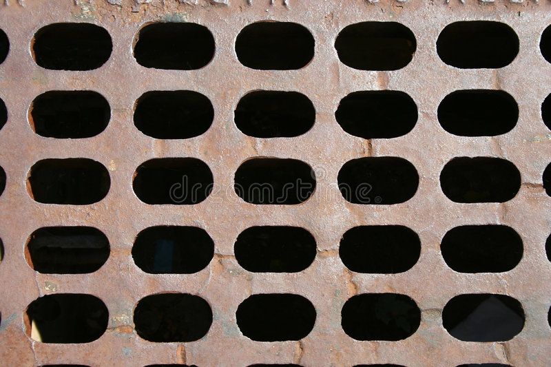 Sewer grate background stock images