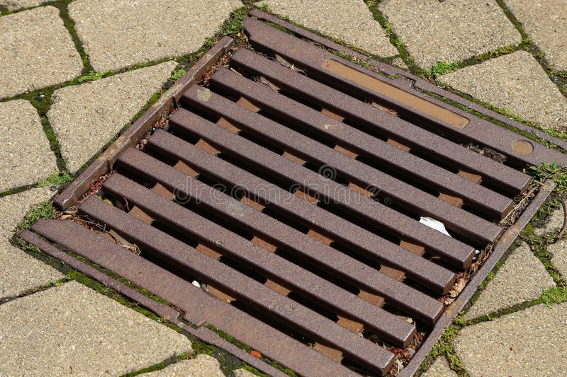 Sewer grid. Iron grid for water flow in sewers.  stock photography