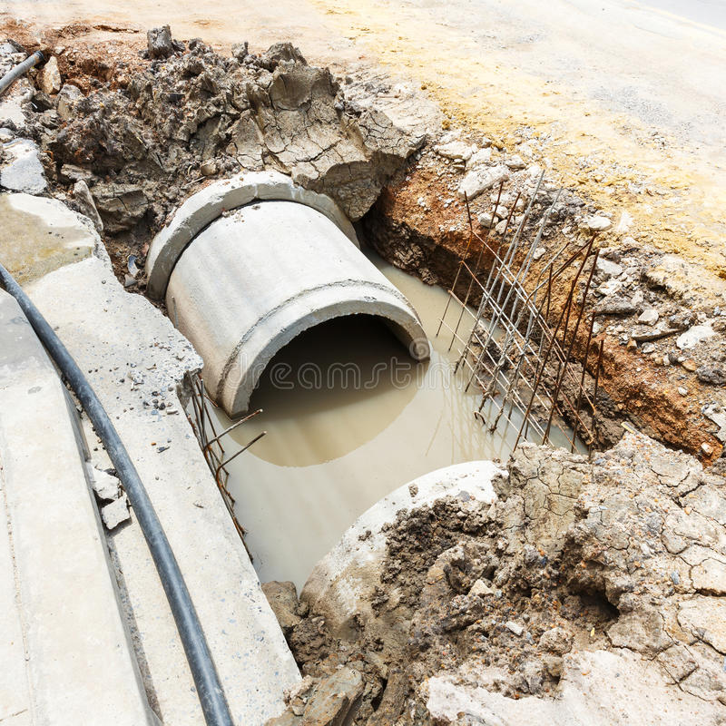 Sewer installation in city stock image