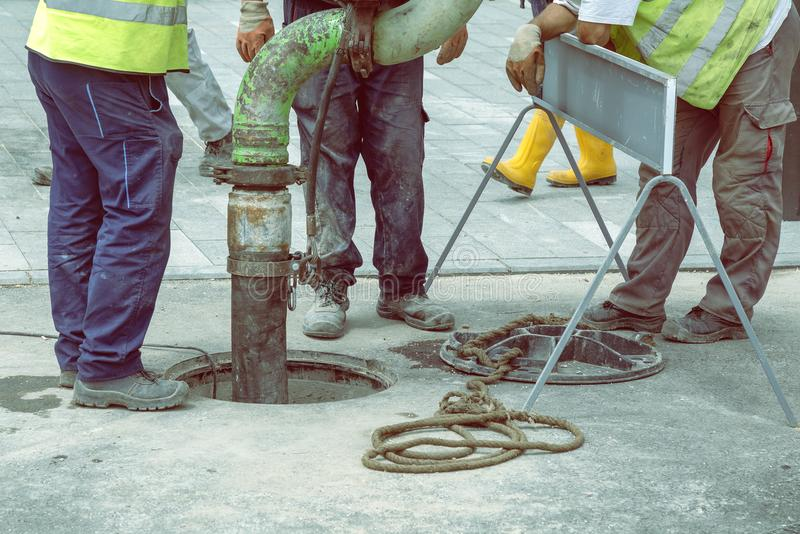 Sewer Lines Cleaning Service 2. Sewer Lines Cleaning Service. Unblock a drain. Cleaning blocked sewer. Color effect royalty free stock photo