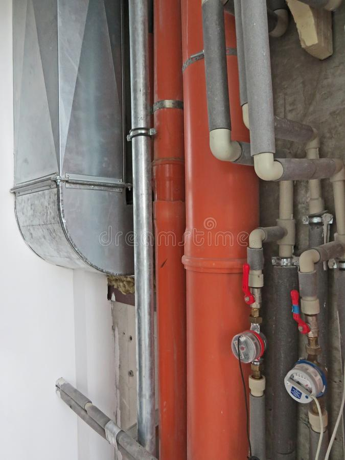 Sewer pipes orange and grey. royalty free stock images
