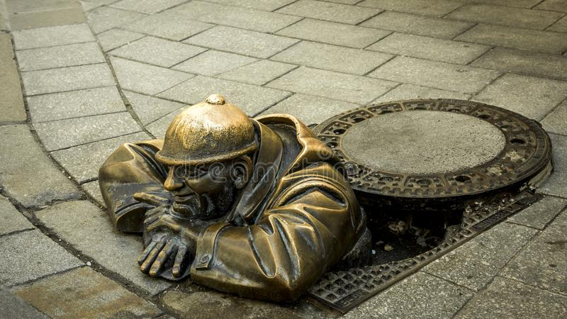 Sewer worker bronze royalty free stock photos