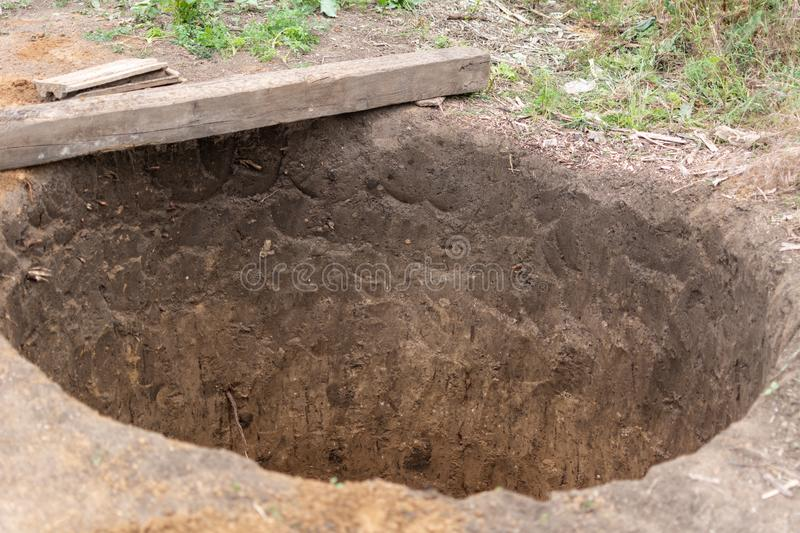 Sewerage construction. Round pit for a septic tank. Sewerage construction royalty free stock photo