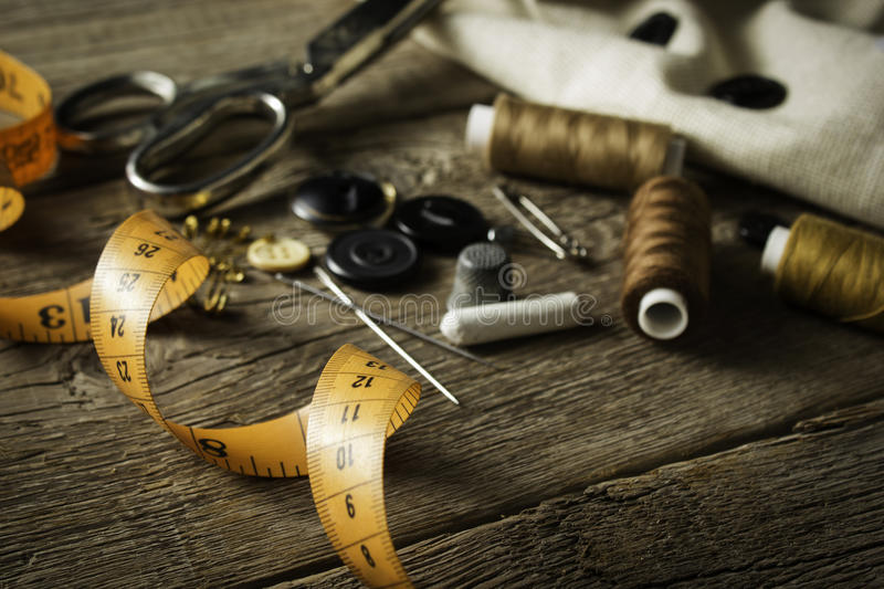 Sewing accessories. On wooden background