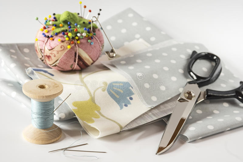 Sewing accessories on white. Dressmaker shear and other accessories royalty free stock photography