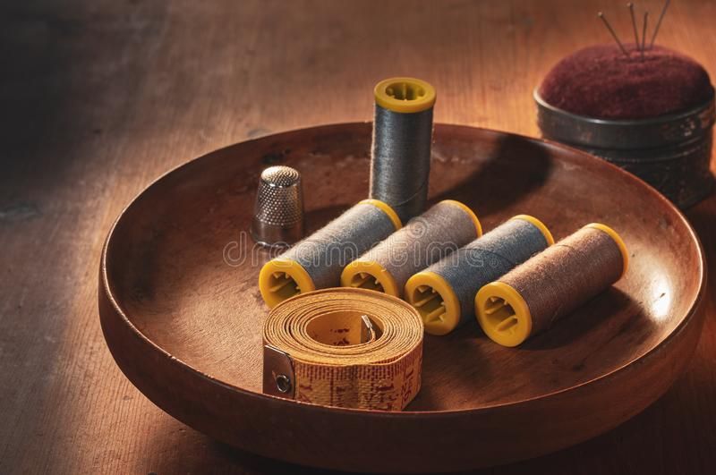 Sewing accessories on wooden table stock image
