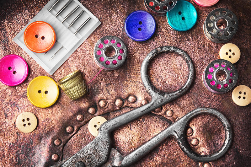 Sewing button set. Multi-colored plastic sewing button and thread coil royalty free stock photo