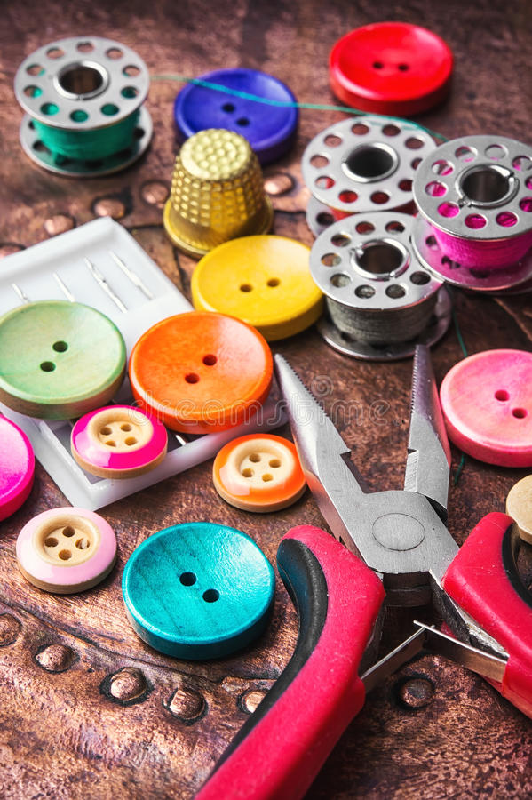 Sewing button set. Multi-colored plastic sewing button and thread coil royalty free stock photos