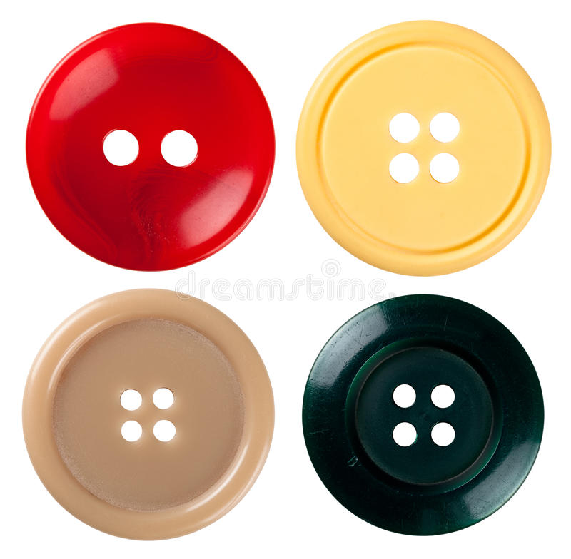 Sewing Buttons. Four varied sewing buttons isolated on white background. Each one is shot separately stock image