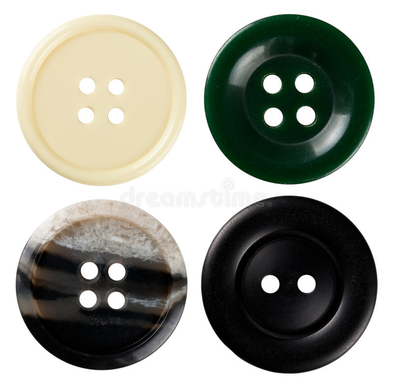 Sewing Buttons. Four varied sewing buttons isolated on white background. Each one is shot separately royalty free stock image
