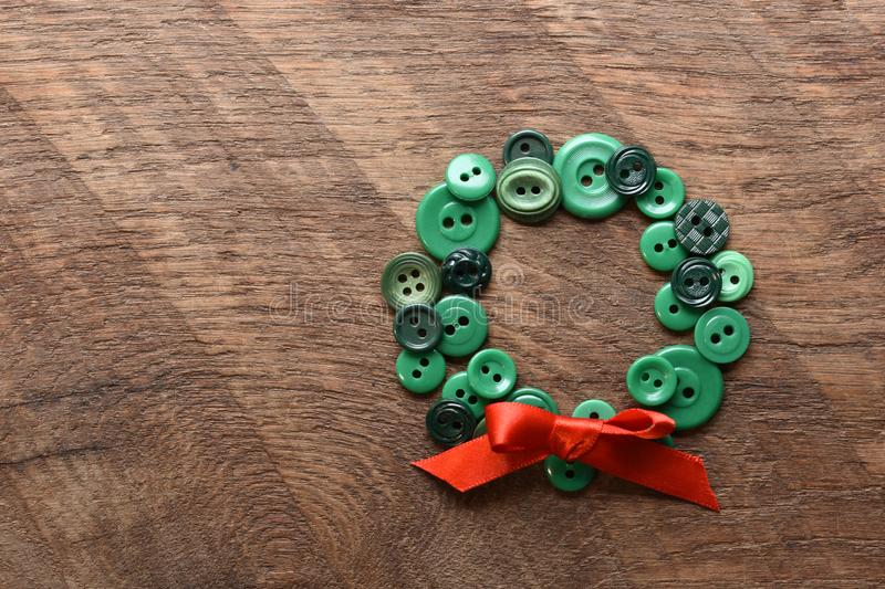 Sewing buttons in the shape of a wreath stock photo