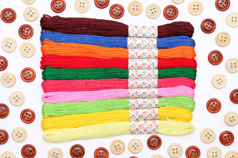 Sewing buttons and threads royalty free stock photos