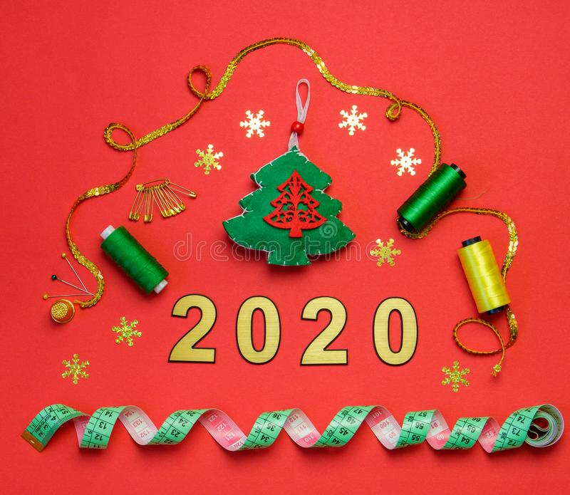 Sewing christmas decoration with numbers 2020 on red background stock image