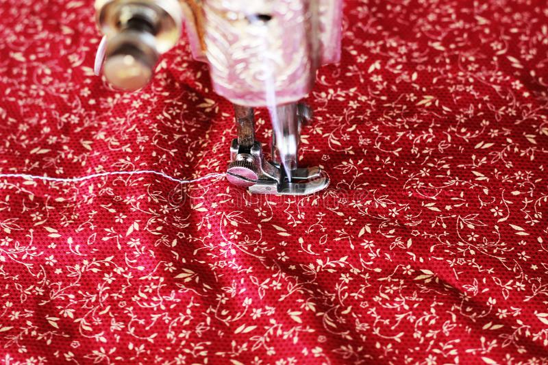 Sewing machine with cloth working. Sewing a colorful cloth vibrant attractive ready for garments dress stock image