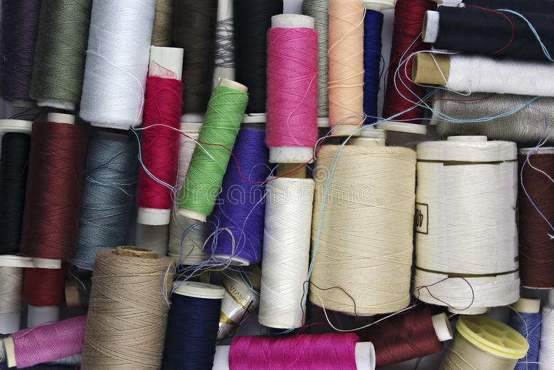 Sewing Cotton. In different colors, packed and unpacked, in plastic box royalty free stock images