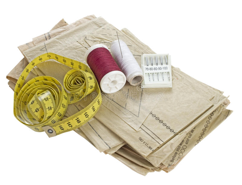 Sewing, dressmaking materials. Pattern, thread, tape measure etc stock image