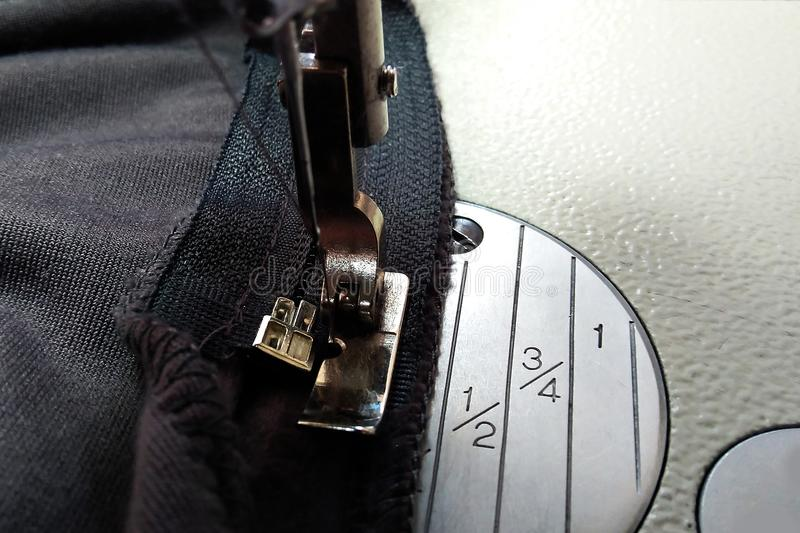 Sewing equipment, sewing zipper on a special machine stock photography