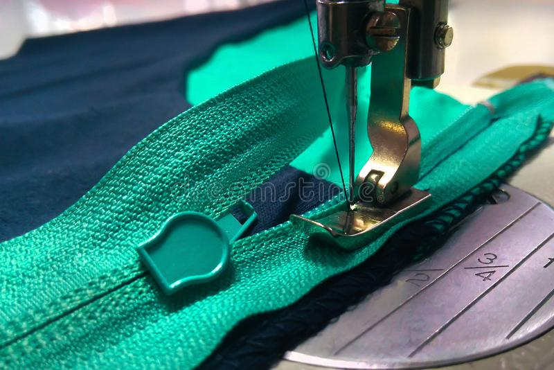 Sewing equipment, zipper sewing operation royalty free stock images