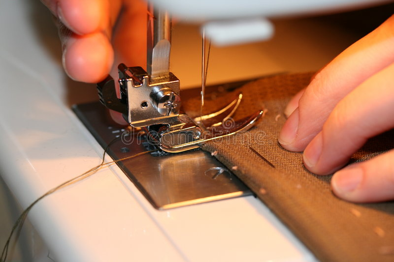 Sewing hands royalty free stock photography