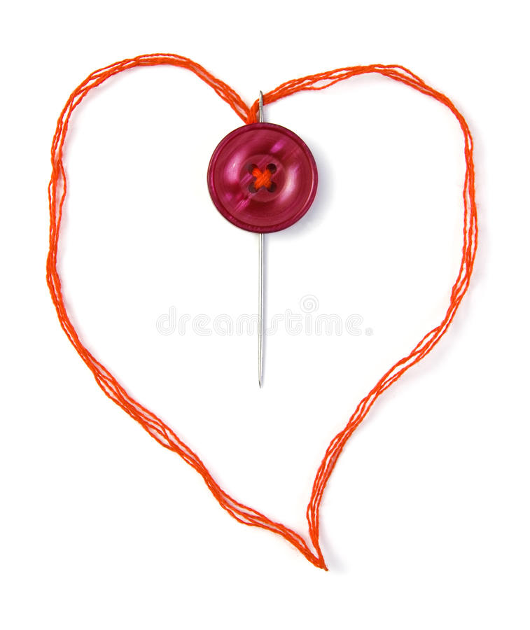 Sewing heart. Red thread in heart shape royalty free stock photography