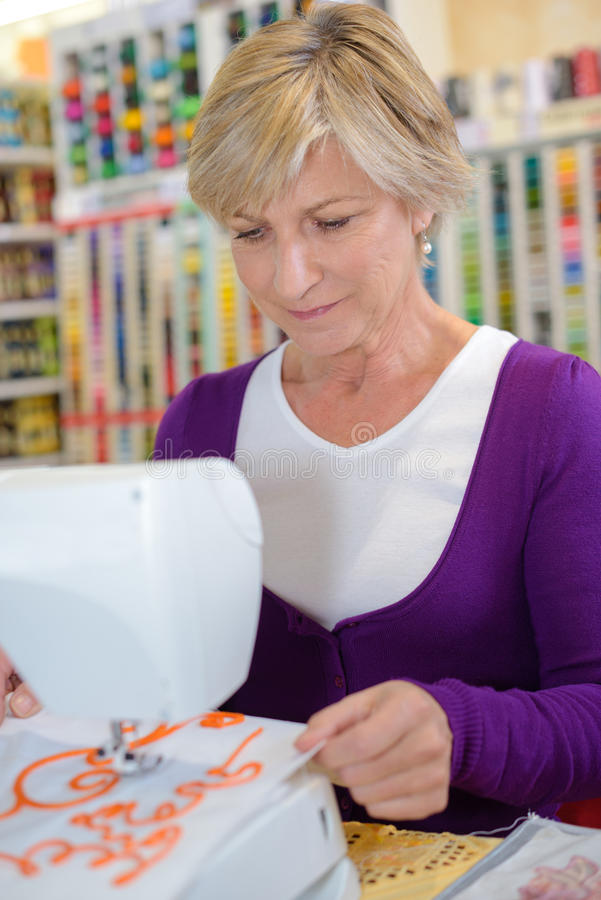 Sewing hobby in shop royalty free stock image