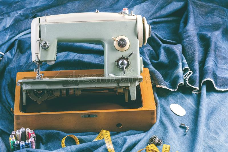 Sewing indigo denim jeans with sewing machine, garment industrial concept. royalty free stock photos