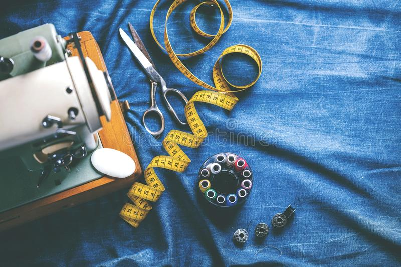 Sewing indigo denim jeans with sewing machine, garment industrial concept. royalty free stock images