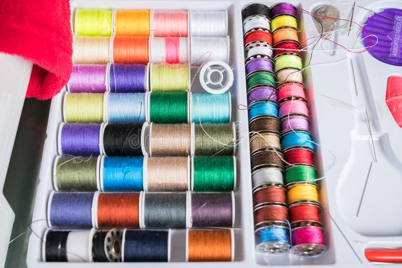 Sewing kit with colored spools royalty free stock photography