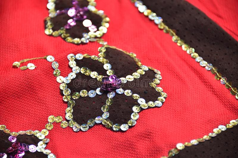 Sewing lessons. (black flower applique royalty free stock images